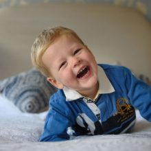 portrait of a boy laughing
