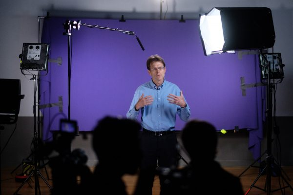 Corporate Photography picture of man being interviewed by the media