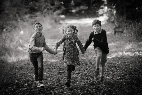 photograph of children running