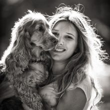 portrait of a teenage girl with her pet dog