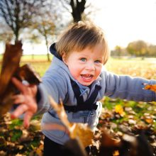Portrait photograph of young boy in the autumnal light