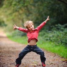 portrait photograph of boy jumping
