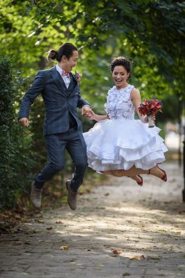 wedding couple jump for joy