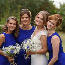 bridesmaids pose with the bride